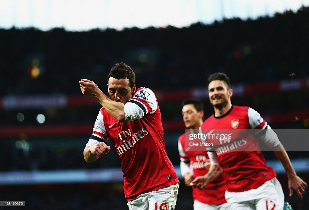 Santi Cazorla of Arsenal (L) celebrates with Olivier Giroud (R) as he scores their first goal during the Barclays Premier League match between Arsenal and Fulham at Emirates Stadium on January 18, 2014 in London, England.