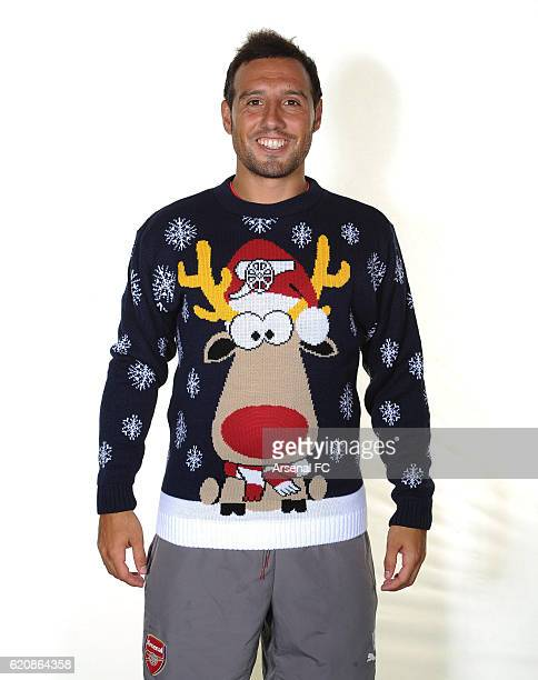 Santi Cazorla of Arsenal in his Arsenal Christmas Jumper to support Save the Children Christmas Jumper Day at London Colney on October 21 2016 in St...