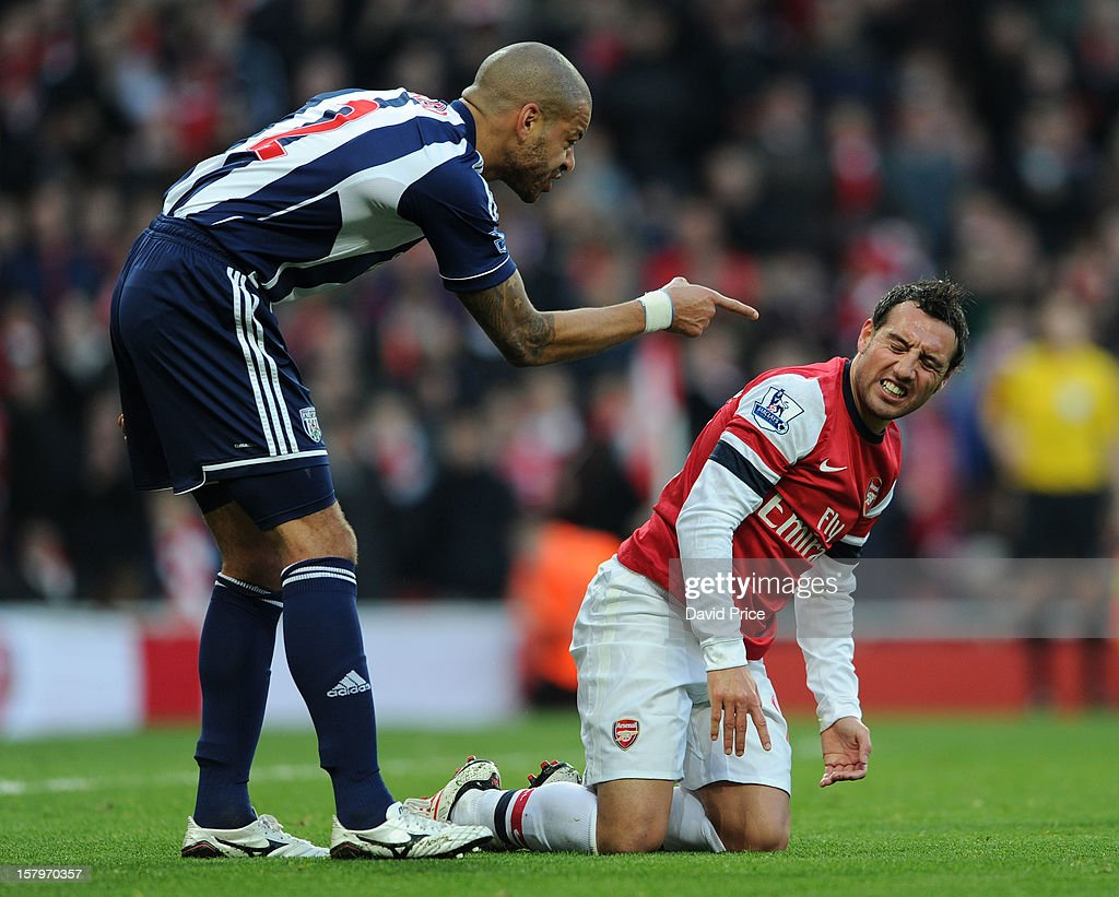 Santi Cazorla of Arsenal is accused of diving by Steve Reid of WBA to win the 1st penalty during the Barclays Premier League match between Arsenal and West Bromwich Albion, at Emirates Stadium on December 08, 2012 in London, England.