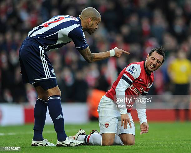 Santi Cazorla of Arsenal is accused of diving by Steve Reid of WBA to win the 1st penalty during the Barclays Premier League match between Arsenal...
