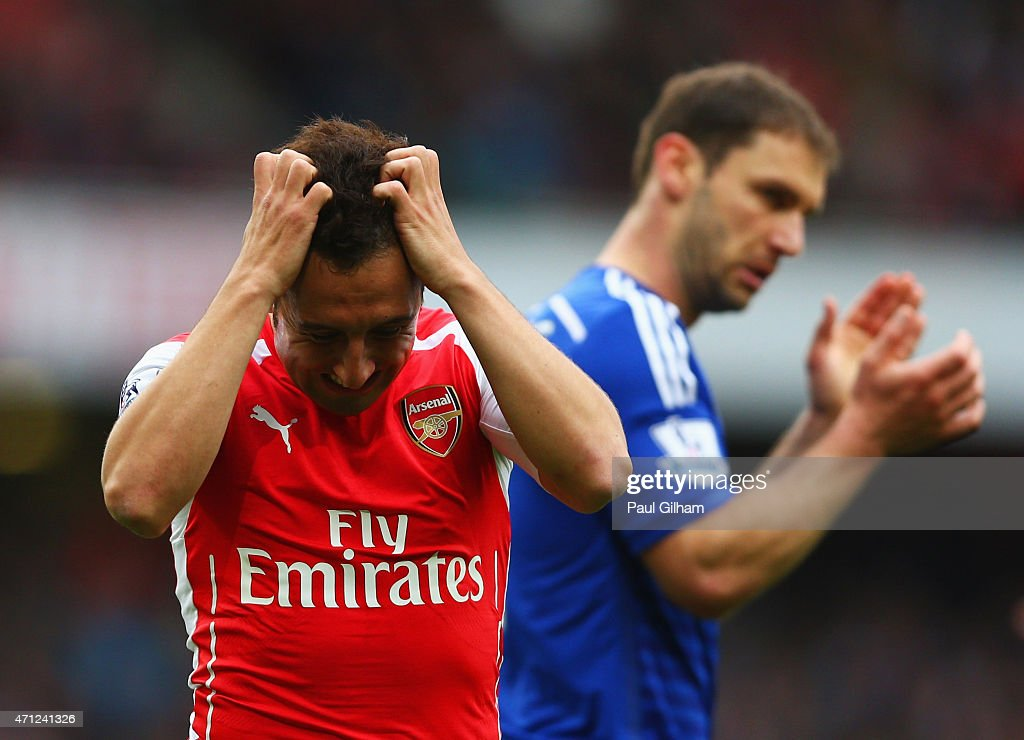 Santi Cazorla of Arsenal reacts after a missed chance during the Barclays Premier League match between Arsenal and Chelsea at Emirates Stadium on April 26, 2015 in London, England.