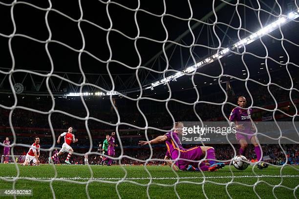 Santi Cazorla of Arsenal reacts as Semih Kaya of Galatasaray AS clears his effort near to the line during the UEFA Champions League group D match...