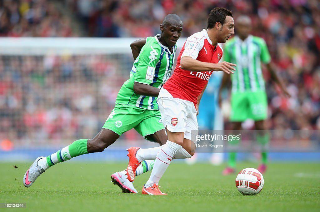 Santi Cazorla of Arsenal runs with the ball during the Emirates Cup match between Arsenal and VfL Wolfsburg at the Emirates Stadium on July 26, 2015 in London, England.