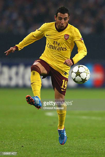 Santi Cazorla of Arsenal runs with the ball during the UEFA Champions League group B match between FC Schalke 04 and Arsenal FC at Veltins Arena on...