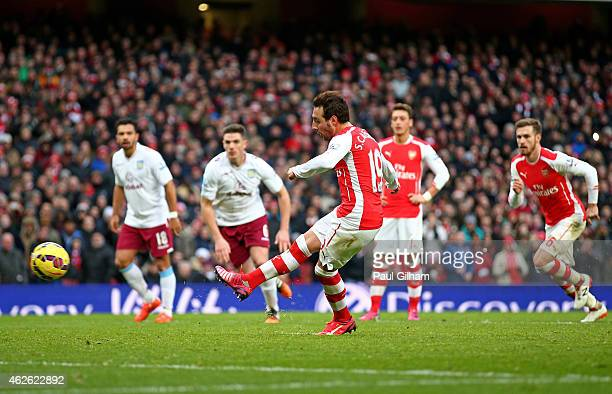 Santi Cazorla of Arsenal scores his team's fourth goal from the penalty spot during the Barclays Premier League match between Arsenal and Aston Villa...