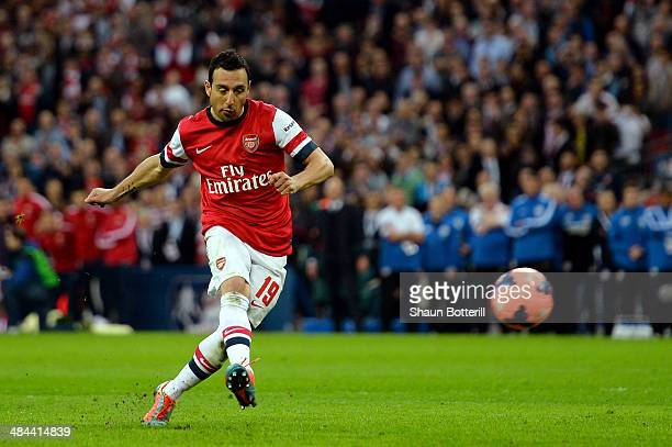 Santi Cazorla of Arsenal scores the winning penalty during the shoot out during the FA Cup SemiFinal match between Wigan Athletic and Arsenal at...