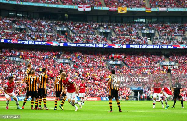 Santi Cazorla of Arsenal scores their first goal from a free kick during the FA Cup with Budweiser Final match between Arsenal and Hull City at...