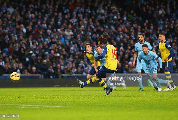 Santi Cazorla of Arsenal scores their first goal from a penalty during the Barclays Premier League match between Manchester City and Arsenal at...
