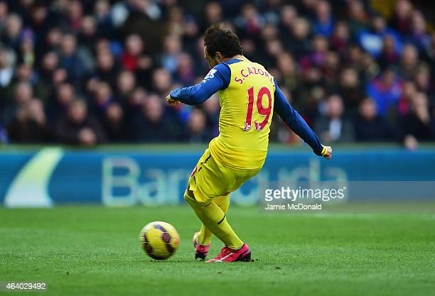 Santi Cazorla of Arsenal scores their first goal from a penalty during the Barclays Premier League match between Crystal Palace and Arsenal at...