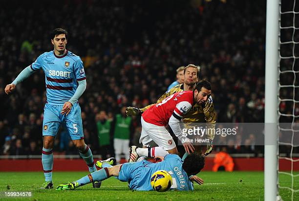 Santi Cazorla of Arsenal scores their thord goal during the Barclays Premier League match between Arsenal and West Ham United at Emirates Stadium on...