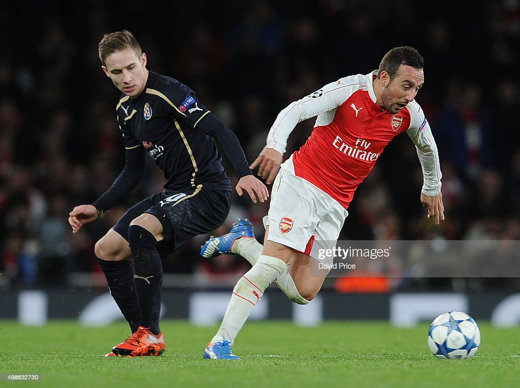 Santi Cazorla of Arsenal skips past Marko Rog of Zagreb during the match between Arsenal and Dinamo Zagreb in the UEFA Champions League on November 24, 2015 in London, United Kingdom.