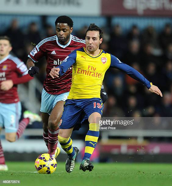 Santi Cazorla of Arsenal takes on Alex Song of West Ham during the match between West ham United and Arsenal in the Barclays Premier League at Boleyn...