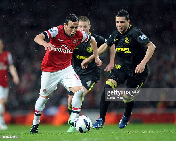 Santi cazorla of Arsenal takes on Antolin Alcaraz of Wigan during the Barclays Premier League match between Arsenal and Everton at Emirates Stadium...