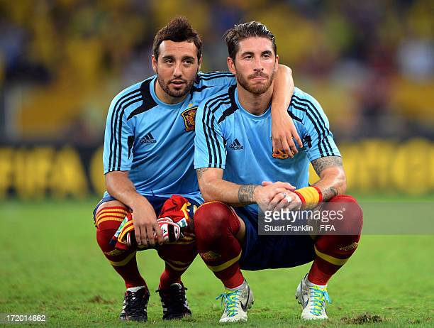 Santi Cazorla of Spain and Sergio Ramos look dejected at the end of the FIFA Confederations Cup Brazil 2013 Final match between Brazil and Spain at...