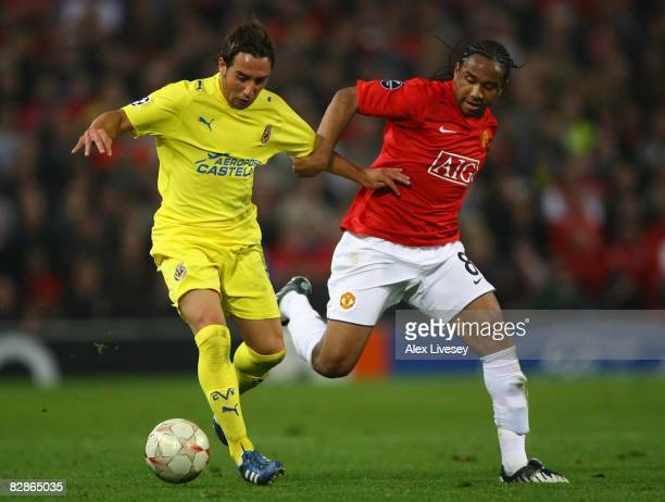 Santi Cazorla of Villareal holds off the challenge of Anderson of Manchester United during the UEFA Champions League Group E match between Manchester...