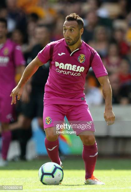 Santi Cazorla of Villareal runs with the ball during the preseason friendly match between Wolverhampton Wanderers and Villareal at Molineux on August...