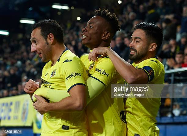 Santi Cazorla of Villarreal ccelebrates after scoring his sides first goal with his teammates Samuel Chimerenka Chukweze and Jaume Costa during the...