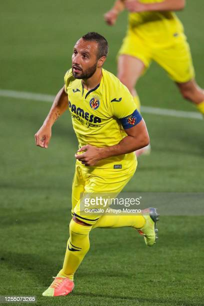 Santi Cazorla of Villarreal CF celebrates after scoring his team's first goal from the penalty spot during the Liga match between Getafe CF and...
