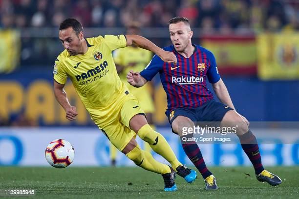 Santi Cazorla of Villarreal CF is challenged by Arthur Melo of FC Barcelona during the La Liga match between Villarreal CF and FC Barcelona at...