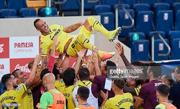 Santi Cazorla of Villarreal CF is thrown in the air by teammates after the La Liga at Estadio de la Ceramica on July 19, 2020 in Villareal, Spain....