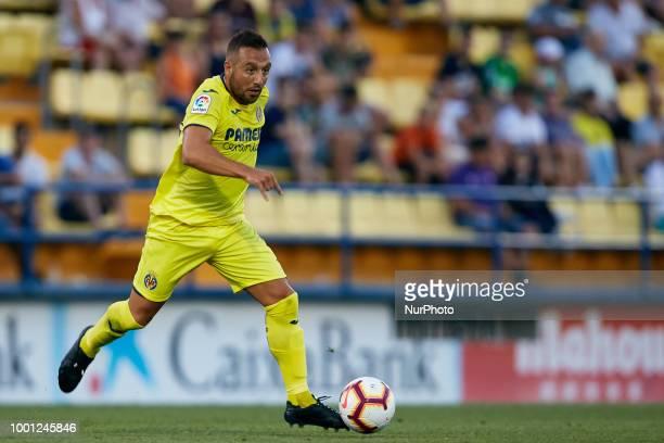 Santi Cazorla of Villarreal CF runs with the ball during the PreSeason Friendly match between Villarreal CF and Hercules CF at Mini Estadi on July 17...