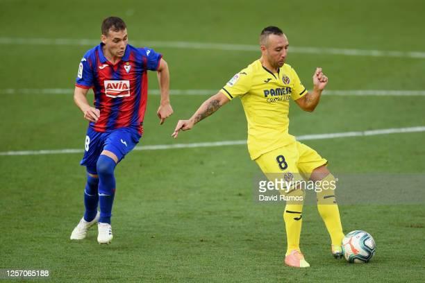 Santi Cazorla of Villarreal is challenged by Sebastian Cristoforo of Eibar during the Liga match between Villarreal CF and SD Eibar SAD at Estadio de...