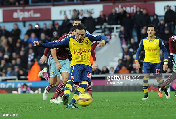 Santi cazorla scores Arsenal's 1st goal from the penalty spot during the match between West ham United and Arsenal in the Barclays Premier League at...