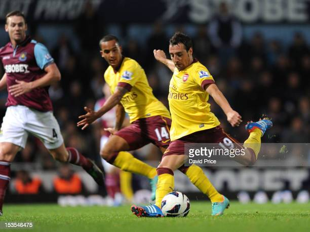 Santi Cazorla scores Arsenal's third goal during the Barclays Premier League match between West Ham United and Arsenal at Boleyn Ground on October 6...