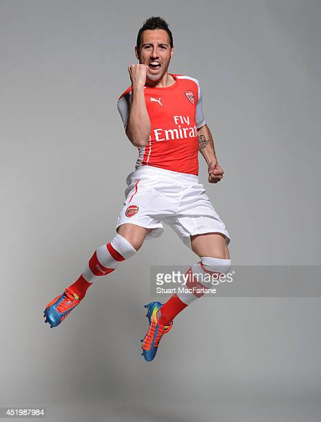 Santi Cazorla wears the new Puma Arsenal kit for season 2013/14 at London Colney on April 23, 2014 in St Albans, England.