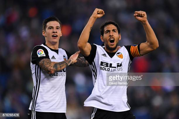 Santi Mina and Dani Parejo of Valencia CF celebrate after Geoffrey Kondogbia of Valencia CF scored the opening goal past Pablo Piatti and Javi Fuego...