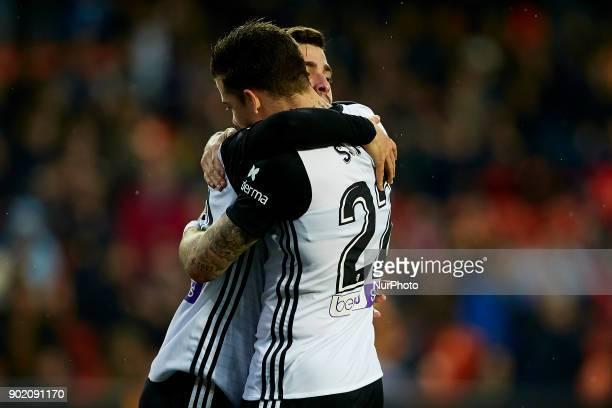 Santi Mina embraces his teammate Gaya of Valencia CF during the La Liga game between Valencia CF and Girona FC at Mestalla on January 6 2018 in...