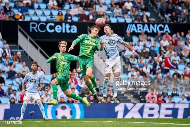 Santi Mina of Celta de Vigo competes for the ball with Diego Llorente of Real Sociedad during the Liga match between RC Celta de Vigo and Real...