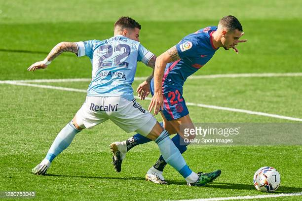 Santi Mina of Celta de Vigo competes for the ball with Mario Hermoso of Atletico de Madrid during the La Liga Santander match between RC Celta and...