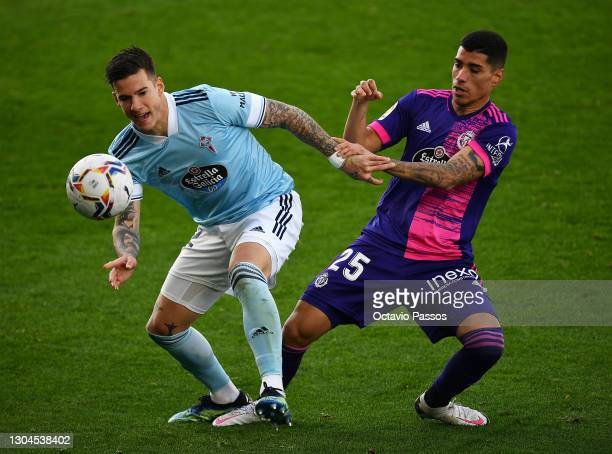 Santi Mina of Celta Vigo battles for possession with Lucas Olaza of Real Valladolid during the La Liga Santander match between RC Celta and Real...