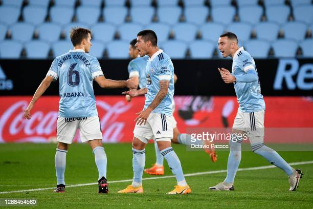 Santi Mina of Celta Vigo celebrates with Denis Suarez after scoring their team's first goal during the La Liga Santander match between RC Celta and...