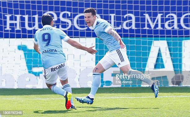 Santi Mina of Celta Vigo celebrates with team mate Nolito after scoring their side's first goal during the La Liga Santander match between SD Huesca...