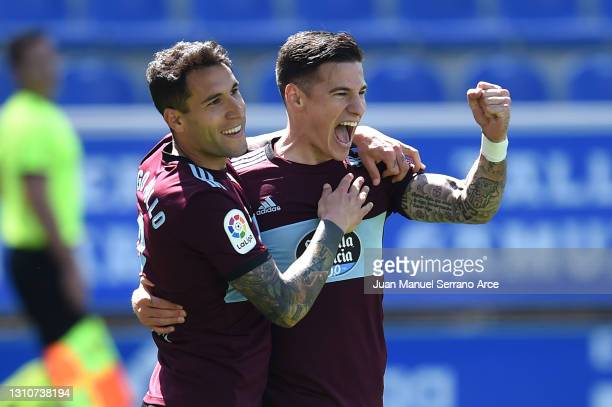 Santi Mina of Celta Vigo celebrates with teammate Hugo Mallo after scoring their team's third goal during the La Liga Santander match between...