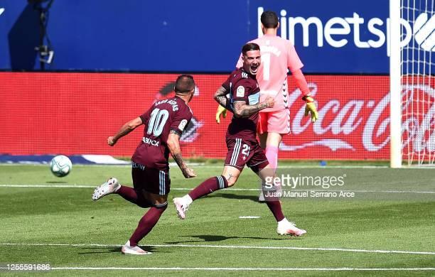 Santi Mina of Celta Vigo celebrates with teammate Iago Aspas after scoring his team's first goal during the Liga match between CA Osasuna and RC...