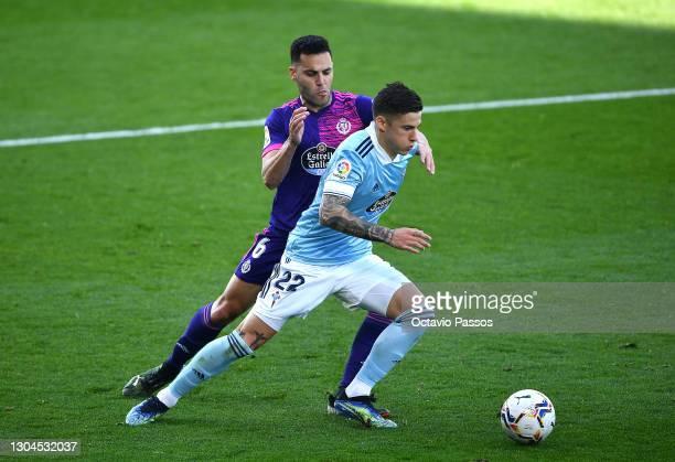 Santi Mina of Celta Vigo is challenged by Bruno Gonzalez of Real Valladolid during the La Liga Santander match between RC Celta and Real Valladolid...