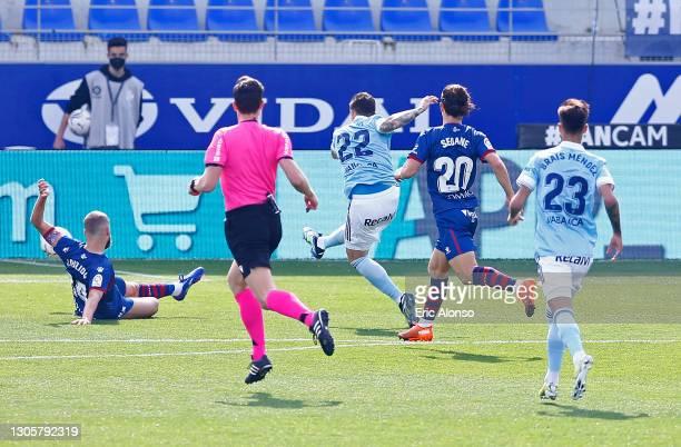 Santi Mina of Celta Vigo scores their side's first goal during the La Liga Santander match between SD Huesca and RC Celta at Estadio El Alcoraz on...