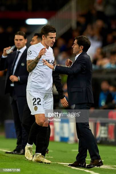 Santi Mina of Valencia adn Marcelino Garcia Toral of Valencia during the Group H match of the UEFA Champions League between Valencia and Young Boys...