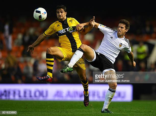Santi Mina of Valencia battle for the ball with Poma of Barakaldo during the Copa del Rey Round of 32 match between Valencia CF and Barakaldo CF at...