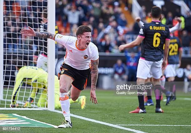 Santi Mina of Valencia celebrates after scoring the second goal during the La Liga match between Valencia CF and RCD Espanyol at Mestalla Stadium on...