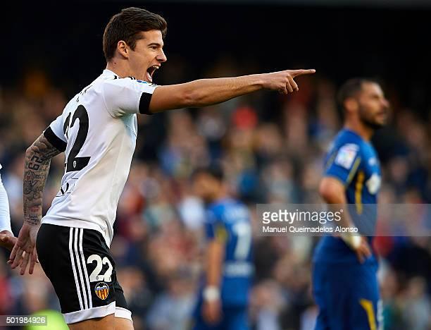 Santi Mina of Valencia celebrates scoring his team's second goal during the La Liga match between Valencia CF and Getafe CF at Estadi de Mestalla on...