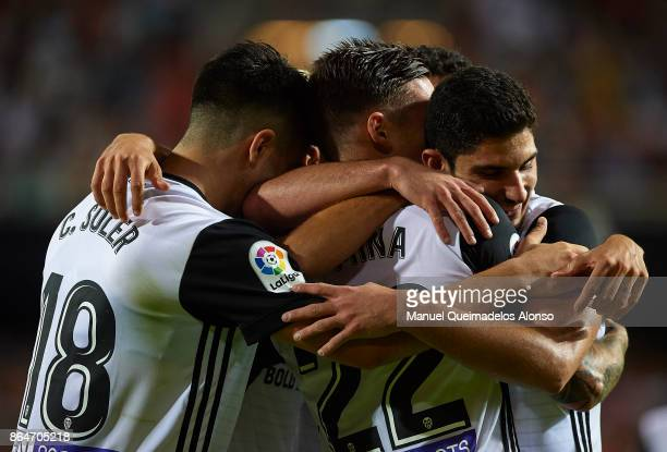 Santi Mina of Valencia celebrates scoring his team's third goal with his teammates Goncalo Guedes and Carlos Soler during the La Liga match between...