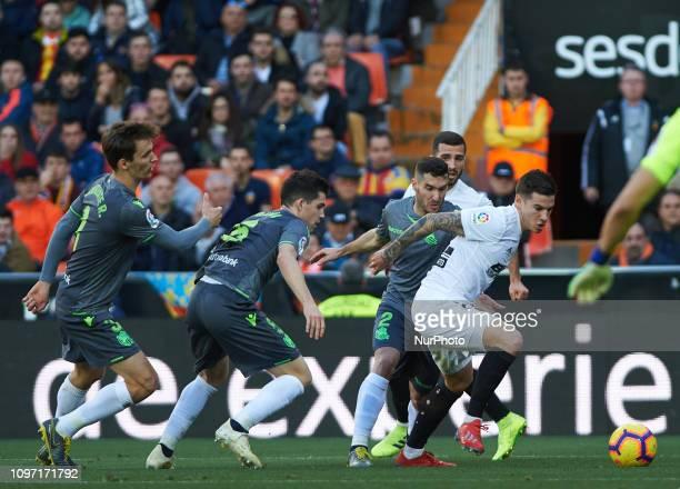 Santi Mina of Valencia CF and Diego Llorente Igor Zubeldia Theo Hernandez of Real Sociedad during the La Liga match between Valencia and Real...