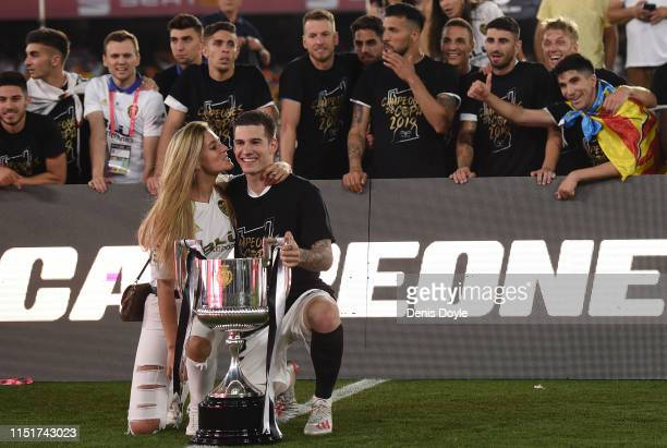 Santi Mina of Valencia CF and his partner celebrate with the trophy at the end of the Spanish Copa del Rey match between Barcelona and Valencia at...