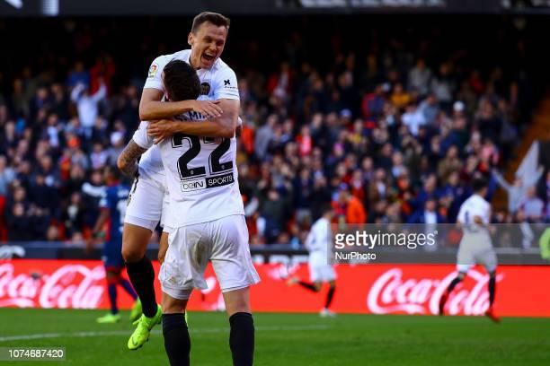 Santi Mina of Valencia CF celebrate after scoring the 10 goal with Denis Cheryshev of Valencia CF during spanish La Liga match between Valencia CF vs...