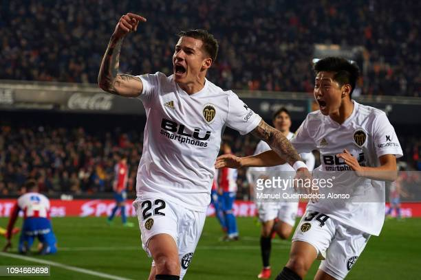 Santi Mina of Valencia CF celebrates after scoring his sides first goal with his teammate Kangin Lee during the Copa del Rey Round of 16 second leg...