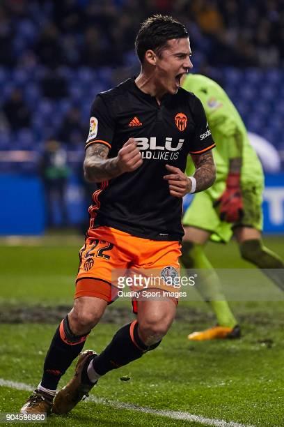 Santi Mina of Valencia CF celebrates the opening goal during the La Liga match between Deportivo La Coruna and Valencia CF at Abanca Riazor Stadium...